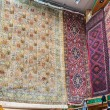 Hand knotted persian carpets on display in a shop Mutrah Souk, Muscat, Oman — Stock Photo #65282015