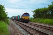 Freight train in Bury St Edmunds Cattishall crossing, UK — Stock Photo