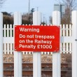 Warning sign on railway level crossing, Cattishall, Bury St Edmu — Stock Photo #67843059
