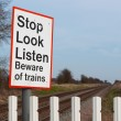 Warning sign on railway level crossing, UK — Stock Photo #67843125