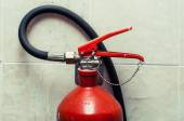 Trigger fire extinguisher — Stock Photo