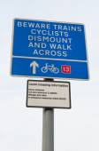 Warning for cyclist Cattishall railway level crossing, UK — Stock Photo