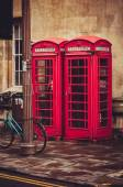 BT red telephone boxes on a street in Cambridge, UK — 图库照片