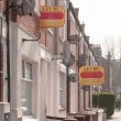 """Estate agent """"let by"""" signs line the road in a suburb of London — Stock Photo #70349399"""