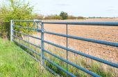 Side view of closed farmland metal gate in England — Stock Photo