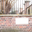 Blank white plate mounted on a street corner — Stock Photo #70643205