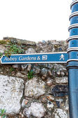 Sign posts for Abbey Gardens & WC in Bury St Edmunds — Stock Photo