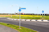 Modern road and roundabout in rural England — Stock Photo