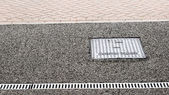 Inspection chamber and drain with metallic cover — 图库照片