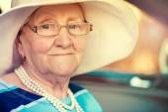 Mature woman in car — Стоковое фото