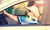 Mature woman driving automobile — Стоковое фото