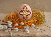 Easter concept. Beaded egg and willow twig — Stock Photo