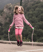 Little girl jumping rope — Stock Photo
