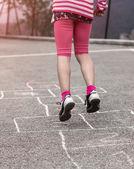 Child on the hopscotch — Stock Photo