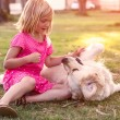 Girl hugging golden retriever dog — Stock Photo #55690475