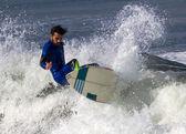 Athlete surfing on San Lorenzo beach — Стоковое фото