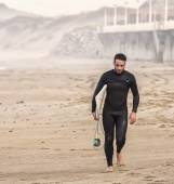 Surfer going out of the water — Stock Photo