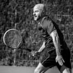 Постер, плакат: Tennis player in match
