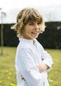 Handsome blond boy in the park — Stock fotografie