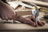 Woodworker hammer a nail — Stock Photo