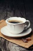 Cup of espresso and brown sugar — Stock Photo