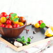 Cherry tomatoes with basil leaves — Stock Photo #70986753