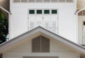 White wooden window and gable of vintage house — Stock Photo