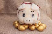 Cute pig doll on golden easter egg — Stock Photo