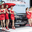Постер, плакат: Unidentified models with Isuzu Mu X