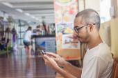 Asian man using smartphone — Stock Photo