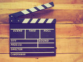 Clapper board on wood background vintage color tone — Stock Photo
