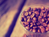 Coffee bean on the cups vintage color tone — Stock Photo