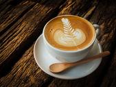 Coffee latte art in coffee shop — Stock Photo