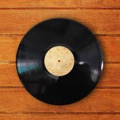 Vinyl record in wood background — Stock Photo