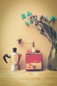 Italian coffee maker and flower — Stock Photo