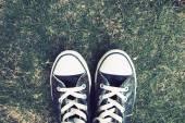 Retro Photo Of Vintage Sneakers On Grass — Stock Photo