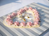 Pink rose on the wedding book in wedding day — Stock Photo
