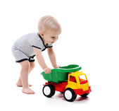 Baby boy play toy truck — Stock Photo