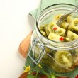 Homemade green tomatoes preserves in glass jar — Stock Photo #52973419