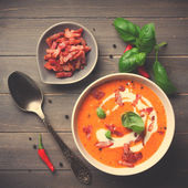 Carrot sweet pepper cream soup with bacon — Stock Photo