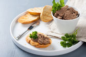 Chicken liver pate on bread and in bawl — Stock Photo