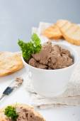 Healthy chicken liver pate with parsley in bawl — Stock Photo