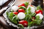 Fresh italian salad with mozzarella cheese — Stock Photo