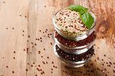 White, red, black and mixed raw quinoa grain — Stock Photo