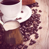 Old coffee pot and cup on wooden rustic background — Stock Photo