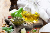 Homemade pesto on a rustic wooden cutting board.  — Stock Photo