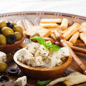 Cubes of feta cheese with olives — Stock Photo