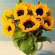 Beautiful sunflowers bouquet in white vase — Stock Photo #77198929