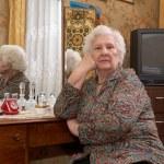 Portrait of senior woman near the mirror — Stock Photo #70117663