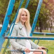 Pregnant woman sitting swing — Stock Photo #56533327